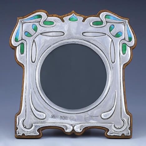 WILLIAM HUTTON, FOR GL CONNELL, ARTS & CRAFTS SILVER & ENAMEL PHOTO FRAME